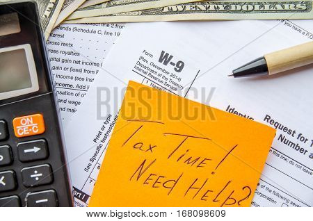 W-9 tax form as a business concept with pen calculator and sticker