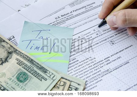 man filling Tax forms 1065 close up