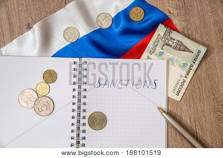 sanctions of russia - flag, money and pen, notes