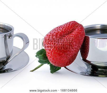 Fresh sweet strawberry and two cups of black coffee against white background.