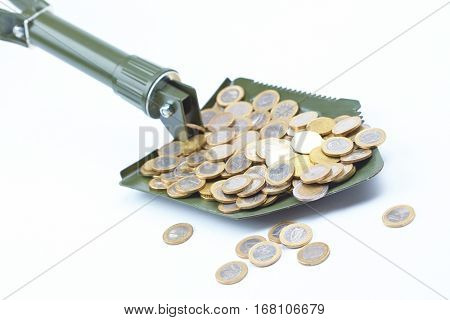 shovel with money