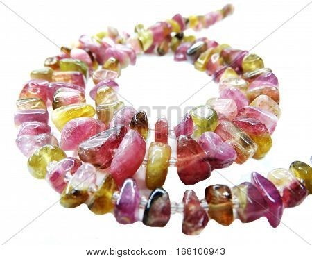 tourmaline gemstone beads isolated on white background