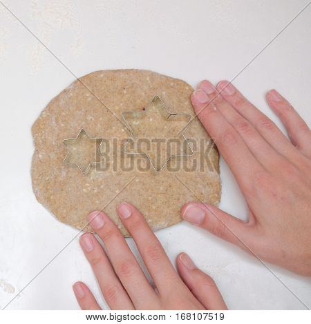 Woman Prepares Rye Dough For Baking. On The Table Poured White Flour And Moulds For Cookies