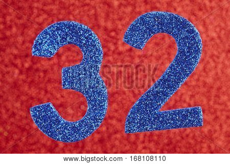 Number thirty-two blue color over a red background. Anniversary. Horizontal
