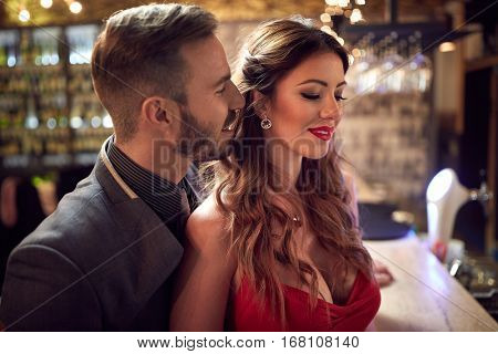 Attractive Caucasian couple flirting indoor