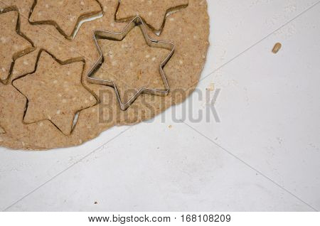 Cutting Christmas Cookies From Rye Dough With Star Shaped Cutter