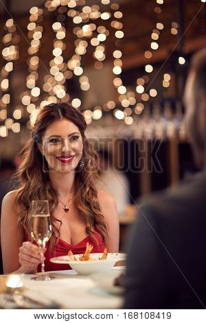 Girlfriend with boyfriend at romantic dinner in restaurant