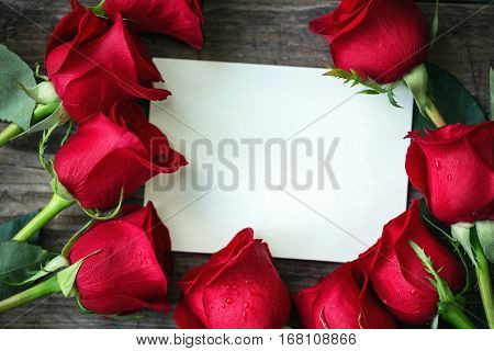 Red roses with empty card and copy space for your own text