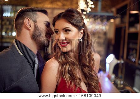 Man and woman enjoying in romantic relationship in pub