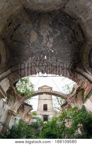 Old ruins of the medieval church - arch and tower