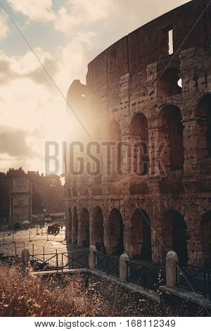 Colosseum at sunset, the world known landmark and the symbol of Rome, Italy.
