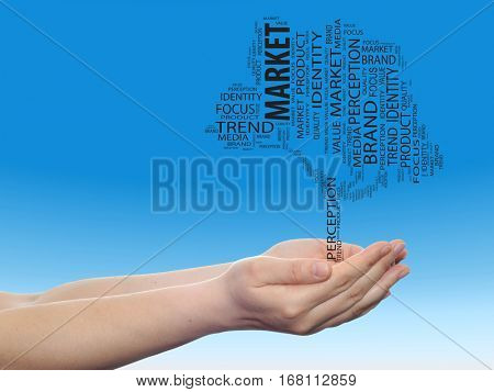 Concept or conceptual tree media word cloud tagcloud in man or woman hand on blue sky background  metaphor to business, trend, focus, market, value, product, advertising or customer or  corporate