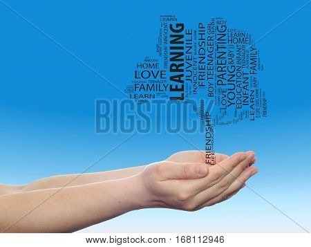 Concept conceptual black education text word cloud or tagcloud as a tree on man or woman hand on blue sky background metaphor to child, family, education, life, home, love and school learn achievement