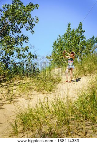 Woman is taking pictures in Sleeping Bear Dunes National Lakeshore in Northern Michigan