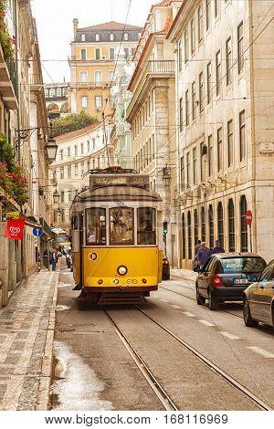 LISBON PORTUGAL - SEPTEMBER 27 2013: Vintage tram in the city center of Lisbon