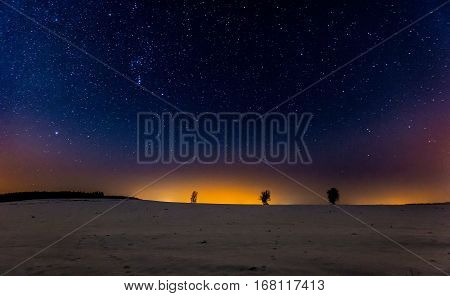Night Sky Over Winter Snowy Fields