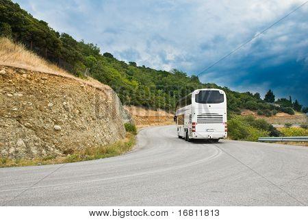 The modern tourist bus on mountain road
