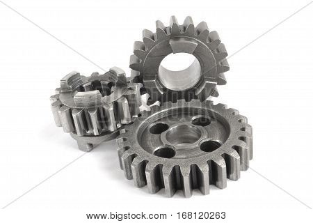Three metal gears on the white background.