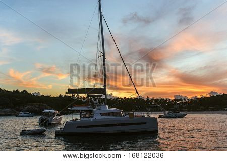 Catamaran at dawn. Romance of the seas