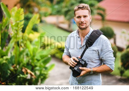 Professional photographer in the warm tropical day enjoying life