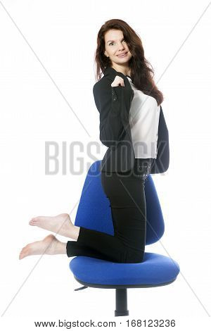 beautiful brunette secretary takes jacket off on office chair in studio against white background