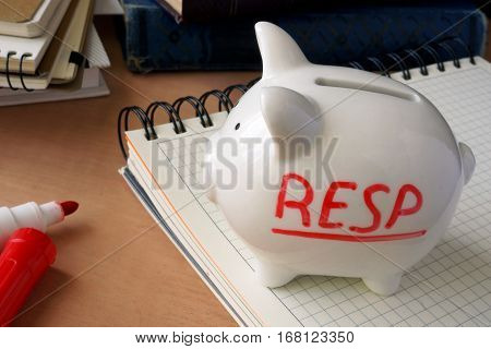 Piggy bank with word RESP. Registered Education Savings Plans.