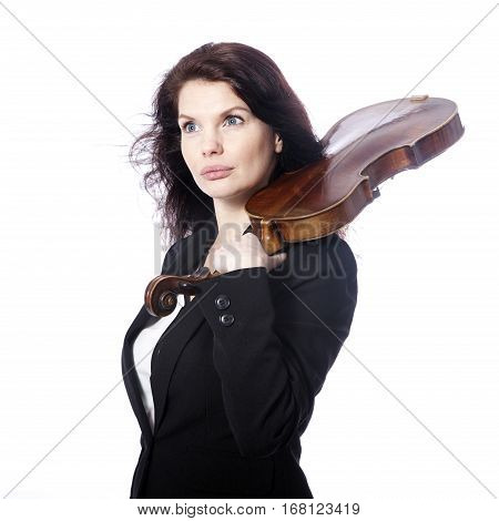 classical brunette beauty in suit holds violin on shoulder in studio against white background