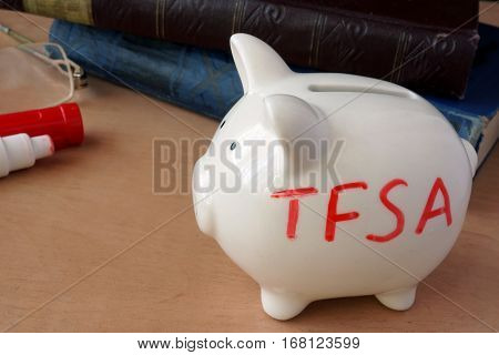 Piggy bank with word TFSA. Tax-free savings accounts.