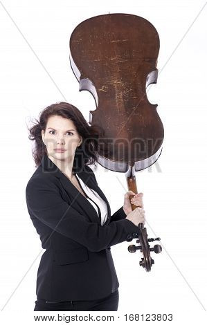 beautiful brunette woman threatens with cello as baseball bat in studio against white background