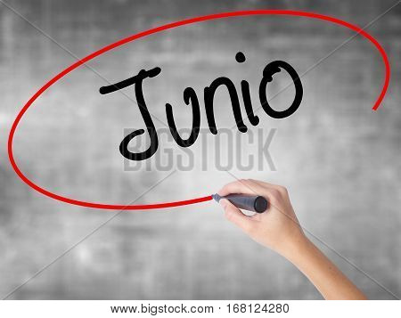 Woman Hand Writing Junio (june In Spanish)   With Black Marker Over Transparent Board