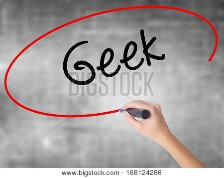 Woman Hand Writing Geek With Black Marker Over Transparent Board