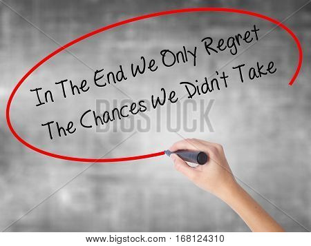 Woman Hand Writing In The End We Only Regret The Chances We Didn't Take With Black Marker Over Trans