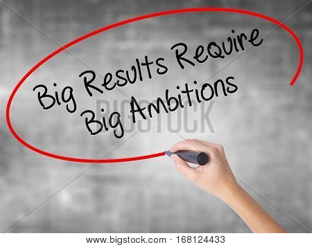 Woman Hand Writing Big Results Require Big Ambitions With Black Marker Over Transparent Board