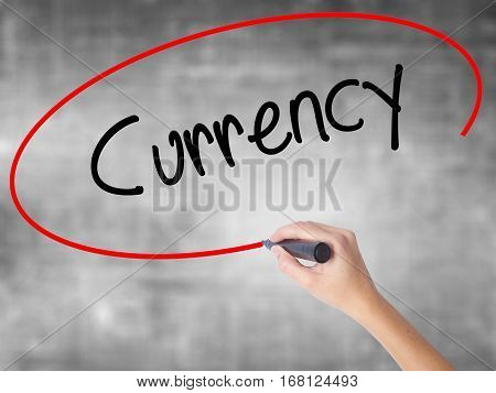 Woman Hand Writing Currency With Black Marker Over Transparent Board