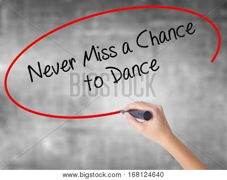 Woman Hand Writing Never Miss A Chance To Dance With Black Marker Over Transparent Board