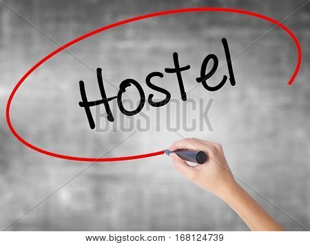 Woman Hand Writing Hostel With Black Marker Over Transparent Board