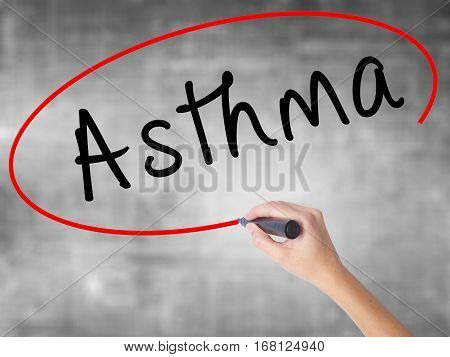 Woman Hand Writing Asthma With Black Marker Over Transparent Board
