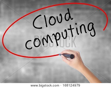 Woman Hand Writing Cloud Computing With Black Marker Over Transparent Board