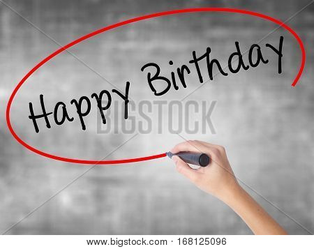 Woman Hand Writing Happy Birthday With Black Marker Over Transparent Board