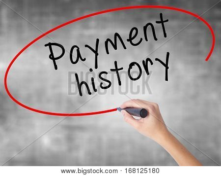 Woman Hand Writing Payment History With Black Marker Over Transparent Board