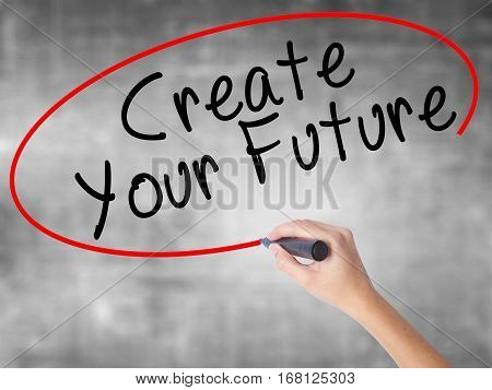 Woman Hand Writing Create Your Future With Black Marker Over Transparent Board