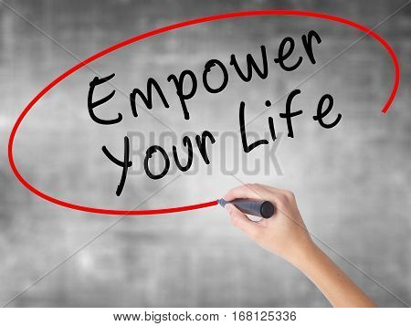 Woman Hand Writing Empower Yourself With Black Marker Over Transparent Board