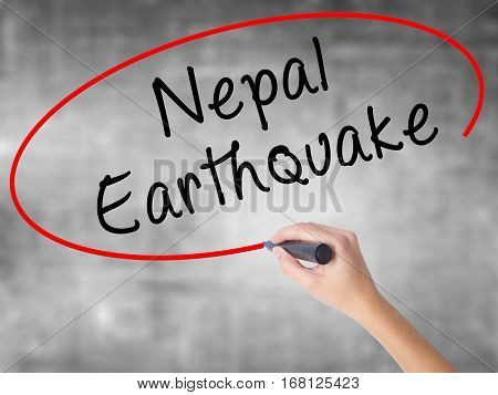 Woman Hand Writing Nepal Earthquake With Black Marker Over Transparent Board