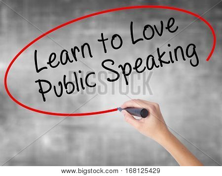 Woman Hand Writing Learn To Love Public Speaking With Black Marker Over Transparent Board