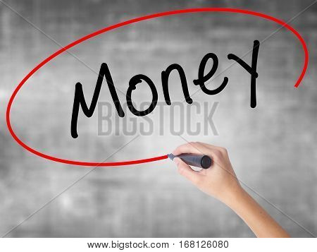 Woman Hand Writing Money With Black Marker Over Transparent Board