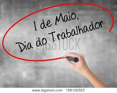Woman Hand Writing  1 De Maio, Dia Do Trabalhador (in Portuguese: 1 May, Labor Day)  With Black Mark