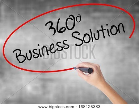 Woman Hand Writing 360 Business Solution With Black Marker Over Transparent Board