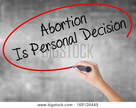 Woman Hand Writing Abortion Is Personal Decision With Black Marker Over Transparent Board