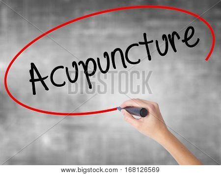 Woman Hand Writing Acupuncture With Black Marker Over Transparent Board.