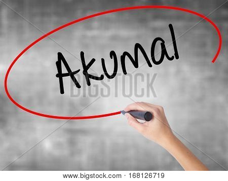Woman Hand Writing Akumal With Black Marker Over Transparent Board